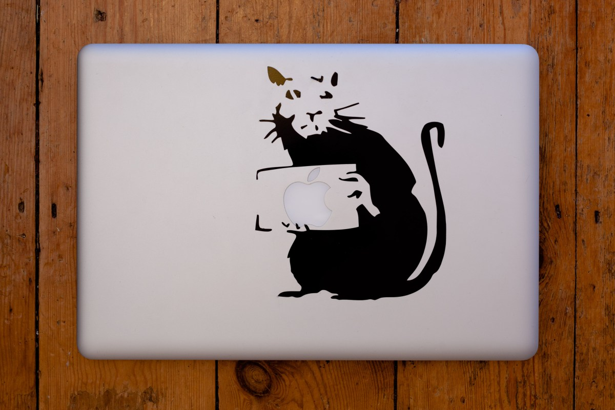 Vinyl decal of a Banksy Rat on my MacBook Pro