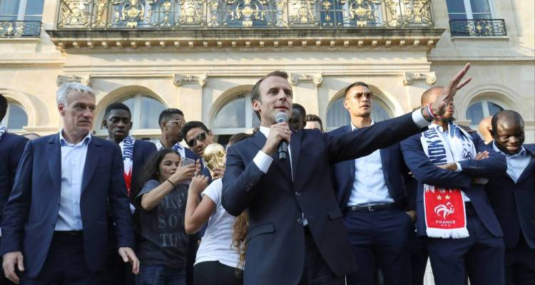 French President Emmanuel Macron speaks next to France's coach Didier Deschamps as he welcomes players of the French national soccer football team after they won the Russia 2018 World Cup final football match, during a reception at the Elysee Presidential Palace, in Paris, France July 16, 2018. Ludovic Marin/Pool via Reuters