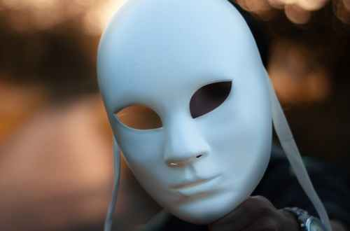 focus photography of white mask, masker