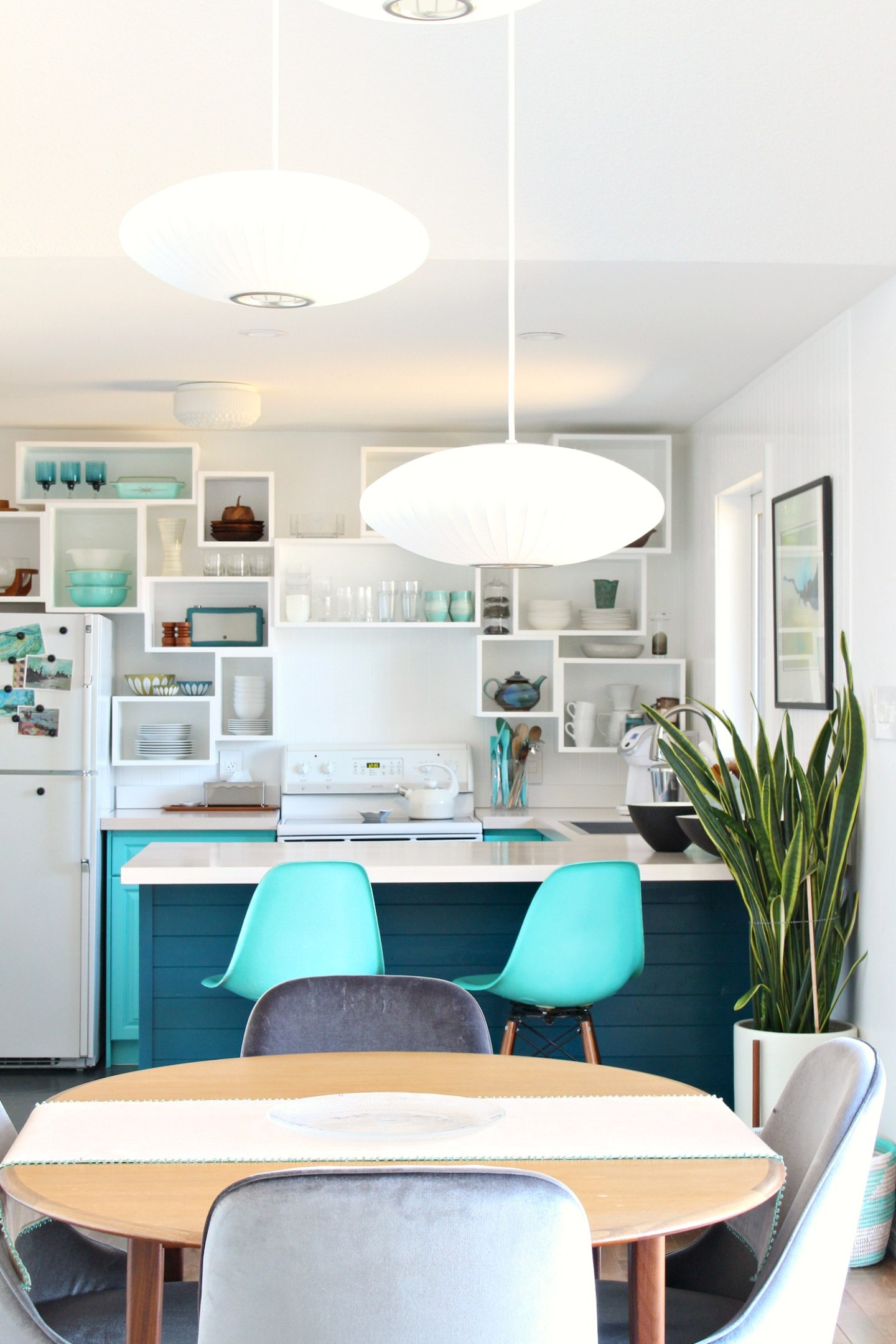 Lake House Kitchen with DIY Wall Cubbies Instead of Open Shelving - a Modern Take on Open Shelving in Kitchens. #openshelving #teal #colorfulhomedecor