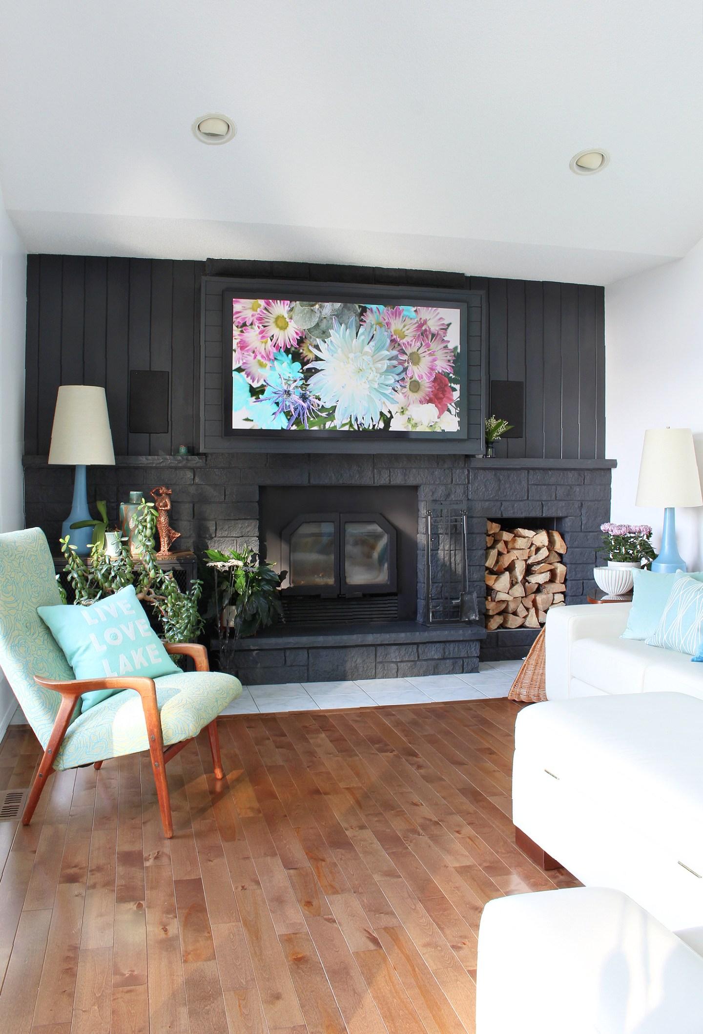 Lake House Fireplace Below a TV