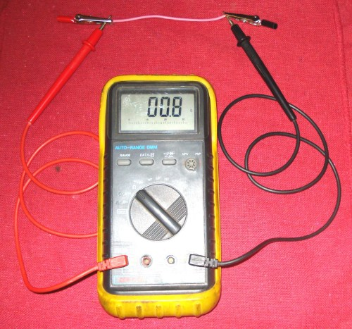 small resolution of the ohm meter reading will be very low if there is a break in the wire there will be no continuity meaning the resistance