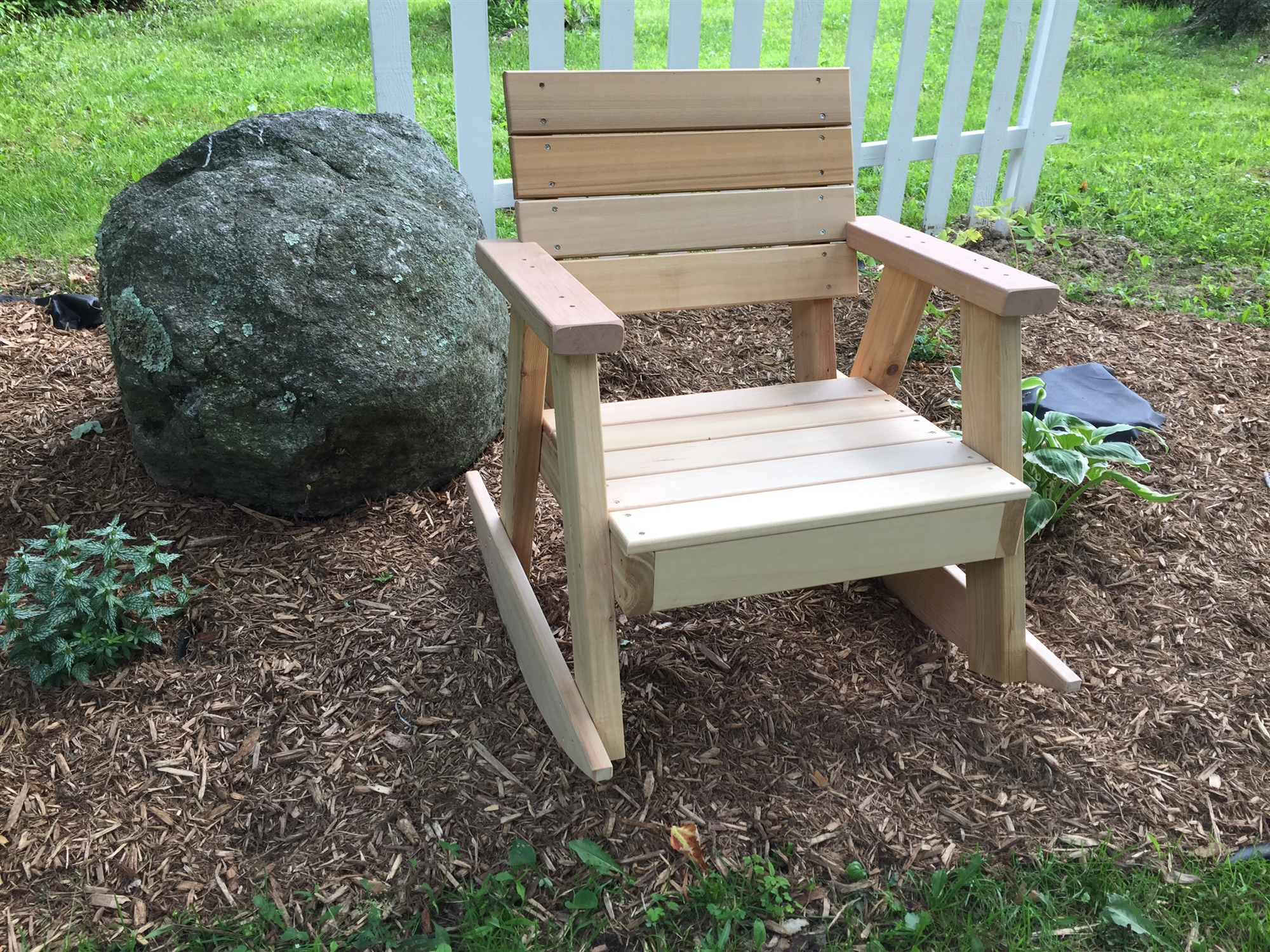 cedar rocking chairs bjorn potty chair w horizontal wooden slats and arm rests