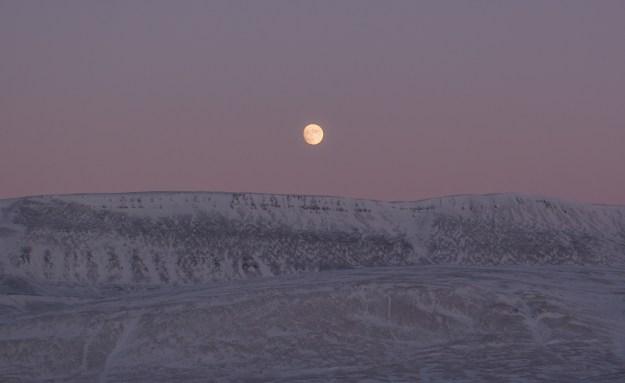 Nearly full moon over Blacktop, near Eureka Airport, Nunavut, Canada