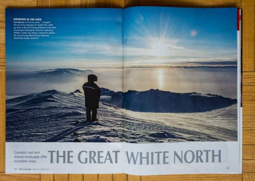 Our Canada (Feb/March 2018) p.44-45, image by Dan Weaver of a Canadian scientist looking out over the foggy high Arctic scenery of Eureka, Nunavut