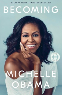 Cover of Becoming by Michelle Obama, featuring a portrait of Obama with a warm smile.