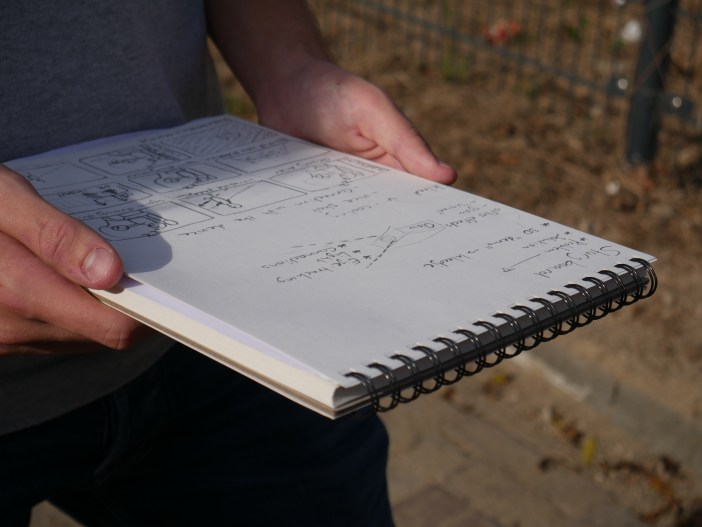 sketch book holding tentamen important storyboard filming