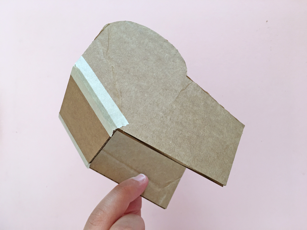 How To Make a Felt Dinosaur Bag Tutorial: Tape the back of head piece to the side head pieces