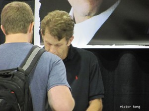 The voice of Batman, Kevin Conroy, signs autographs for a fan