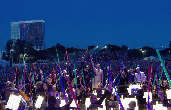 SAN DIEGO, CA - JULY 10: (L-R) Producer Kathleen Kennedy, director J.J. Abrams, actors John Boyega, Daisy Ridley, Oscar Isaac, Gwendoline Christie, Domhnall Gleeson, Carrie Fisher, Mark Hamill, Harrison Ford and more than 6000 fans enjoyed a surprise `Star Wars` Fan Concert performed by the San Diego Symphony, featuring the classic `Star Wars` music of composer John Williams, at the Embarcadero Marina Park South on July 10, 2015 in San Diego, California. (Photo by Michael Buckner/Getty Images for Disney) *** Local Caption *** Harrison Ford; Mark Hamill; Carrie Fisher; Domhnall Gleeson; Gwendoline Christie; Adam Driver; Oscar Isaac; Daisy Ridley; John Boyega; J.J. Abrams; Kathleen Kennedy