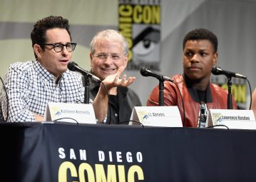 SAN DIEGO, CA - JULY 10: (L-R) Director J.J. Abrams, screenwriter Lawrence Kasdan and actor John Boyega at the Hall H Panel for `Star Wars: The Force Awakens` during Comic-Con International 2015 at the San Diego Convention Center on July 10, 2015 in San Diego, California. (Photo by Michael Buckner/Getty Images for Disney) *** Local Caption *** J.J. Abrams; Lawrence Kasdan; John Boyega