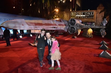 "HOLLYWOOD, CA - DECEMBER 10: Actor Diego Luna (C) and family attend The World Premiere of Lucasfilm's highly anticipated, first-ever, standalone Star Wars adventure, ""Rogue One: A Star Wars Story"" at the Pantages Theatre on December 10, 2016 in Hollywood, California. (Photo by Marc Flores/Getty Images for Disney) *** Local Caption *** Diego Luna"