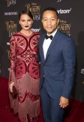 "LOS ANGELES, CA - MARCH 02: Model Chrissy Teigen and singer John Legend arrive for the world premiere of Disney's live-action ""Beauty and the Beast"" at the El Capitan Theatre in Hollywood as the cast and filmmakers continue their worldwide publicity tour on March 2, 2017 in Los Angeles, California. (Photo by Jesse Grant/Getty Images for Disney) *** Local Caption *** Chrissy Teigen; John Legend"