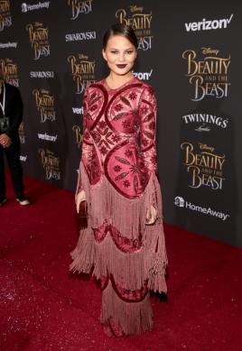 "LOS ANGELES, CA - MARCH 02: Model Chrissy Teigen arrives for the world premiere of Disney's live-action ""Beauty and the Beast"" at the El Capitan Theatre in Hollywood as the cast and filmmakers continue their worldwide publicity tour on March 2, 2017 in Los Angeles, California. (Photo by Jesse Grant/Getty Images for Disney) *** Local Caption *** Chrissy Teigen"
