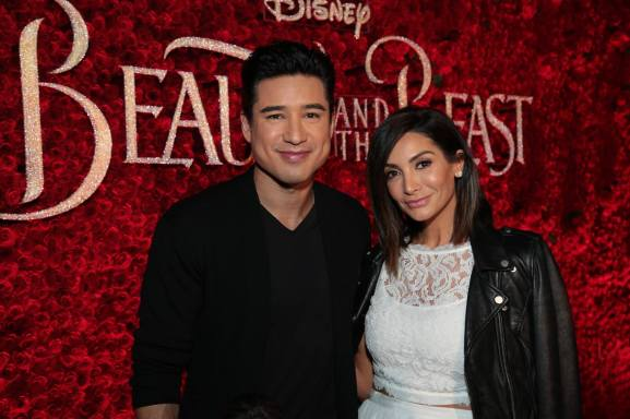 """Mario Lopez and Courtney Laine Mazza arrive for the world premiere of Disney's live-action """"Beauty and the Beast"""" at the El Capitan Theatre in Hollywood as the cast and filmmakers continue their worldwide publicity tour. (Photo: Alex J. Berliner/ABImages)"""