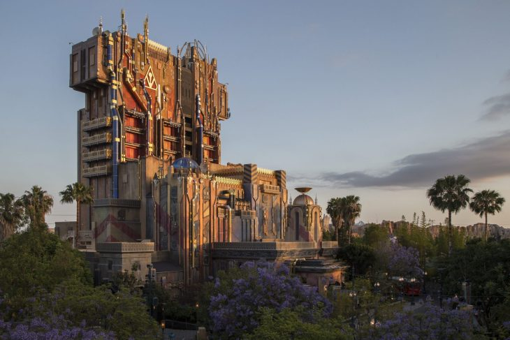 "Guardians of the Galaxy--Mission: BREAKOUT! — The exterior of The Collector's Fortress shimmers at dusk at Disney California Adventure Park. The all-new attraction Guardians of the Galaxy–Mission: BREAKOUT! will take guests through the Fortress of The Collector, who is keeping his newest acquisitions, the Guardians of the Galaxy, as prisoners. Guests will board a gantry lift which launches them into a daring adventure as they join Rocket in an attempt to set free his fellow Guardians. The epic new adventure blasts guests straight into the ""Guardians of the Galaxy"" story for the first time, alongside characters from the blockbuster films and comics. As guests join Rocket in his attempt to bust his pals out of The Collector's Fortress, they will experience randomized ride experiences complete with new visual and audio effects and music inspired by the popular film soundtracks. (Joshua Sudock/Disneyland Resort)"