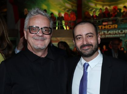 """HOLLYWOOD, CA - OCTOBER 10: Composer Mark Mothersbaugh (L) and Executive producer Brad Winderbaum at The World Premiere of Marvel Studios' """"Thor: Ragnarok"""" at the El Capitan Theatre on October 10, 2017 in Hollywood, California. (Photo by Rich Polk/Getty Images for Disney) *** Local Caption *** Mark Mothersbaugh; Brad Winderbaum"""