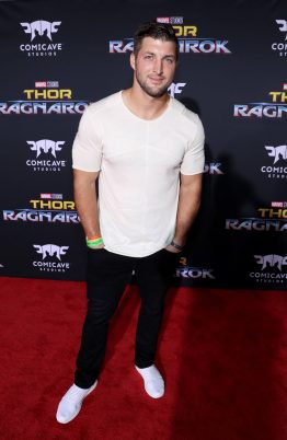 """HOLLYWOOD, CA - OCTOBER 10: Professional football player Tim Tebow at The World Premiere of Marvel Studios' """"Thor: Ragnarok"""" at the El Capitan Theatre on October 10, 2017 in Hollywood, California. (Photo by Rich Polk/Getty Images for Disney) *** Local Caption *** Tim Tebow"""