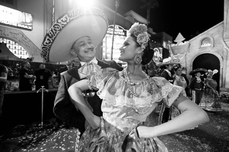 """HOLLYWOOD, CA - NOVEMBER 08: (EDITORS NOTE: Image has been converted to black and white) Dancers perform at the U.S. Premiere of Disney-Pixarís """"Coco"""" at the El Capitan Theatre on November 8, 2017, in Hollywood, California. (Photo by Charley Gallay/Getty Images for Disney)"""