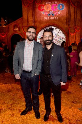 """HOLLYWOOD, CA - NOVEMBER 08: Co-Director/screenwriter Adrian Molina (R) and husband Ryan Dooley at the U.S. Premiere of Disney-Pixarís """"Coco"""" at the El Capitan Theatre on November 8, 2017, in Hollywood, California. (Photo by Alberto E. Rodriguez/Getty Images for Disney) *** Local Caption *** Adrian Molina; Ryan Dooley"""
