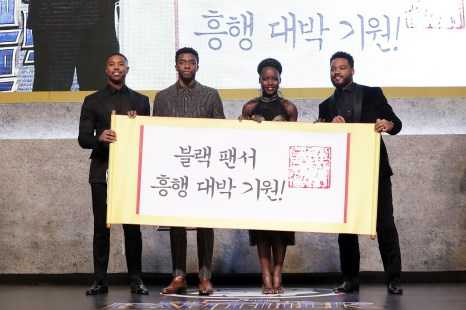 SEOUL, SOUTH KOREA - FEBRUARY 05: Actor Michael B. Jordan, Lupita Nyong'o, Chadwick Boseman and director Ryan Coogler(Left to Right) hold placard wishing the success of the movie in the red carpet event for the Seoul premiere of 'Black Panther' on February 5, 2018 in Seoul, South Korea. (Photo by Han Myung-Gu/Getty Images for Disney) *** Local Caption *** Michael B. Jordan; Lupita Nyong'o; Chadwick Boseman; Ryan Coogler