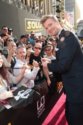 "Joonas Suotamo signs autographs at the world premiere of ""Solo: A Star Wars Story"" in Hollywood on May 10, 2018. (Photo: Alex J. Berliner/ABImages)"