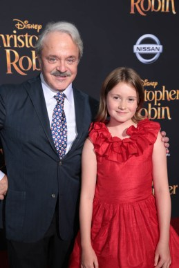 """Jim Cummings and Bronte Carmichael pose together at the world premiere of Disney's """"Christopher Robin"""" at the Main Theater on the Walt Disney Studios lot in Burbank, CA on July 30, 2018. (Photo: Alex J. Berliner/ABImages)"""