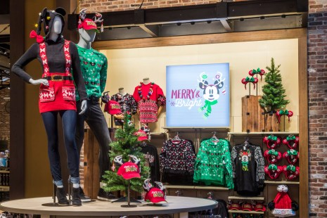 "During the holiday season, holiday wear including ""ugly sweaters"" with patterns inspired by Disney Parks can be found throughout Disneyland Resort in California and Walt Disney World Resort in Florida. Other seasonal wear includes spirit jerseys, hoodies with ears and patterned crew socks with fun knit details. (Joshua Sudock/Disneyland Resort)"