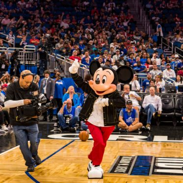 Mickey Mouse makes a surprise on-court appearance March 25, 2019, at Amway Center in Orlando, Florida, His appearance followed an announcement that the new NBA Experience will open Aug. 12, 2019, at Walt Disney World Resort. NBA Experience is an all-new destination coming to Disney Springs in Lake Buena Vista, Fla., that will give guests the chance to feel like a basketball superstar. (Disney, Matt Stroshane)