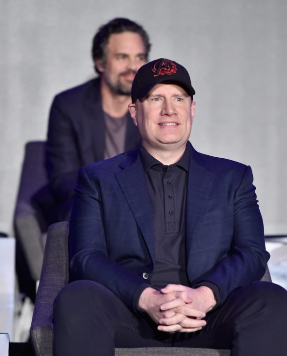 """LOS ANGELES, CA - APRIL 07: President of Marvel Studios/Producer Kevin Feige (front) and Mark Ruffalo speak onstage during Marvel Studios' """"Avengers: Endgame"""" Global Junket Press Conference at the InterContinental Los Angeles Downtown on April 7, 2019 in Los Angeles, California. (Photo by Alberto E. Rodriguez/Getty Images for Disney) *** Local Caption *** Kevin Feige; Mark Ruffalo"""