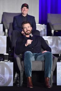 """LOS ANGELES, CA - APRIL 07: Chris Evans (front) and President of Marvel Studios/Producer Kevin Feige speak onstage during Marvel Studios' """"Avengers: Endgame"""" Global Junket Press Conference at the InterContinental Los Angeles Downtown on April 7, 2019 in Los Angeles, California. (Photo by Alberto E. Rodriguez/Getty Images for Disney) *** Local Caption *** Chris Evans; Kevin Feige"""