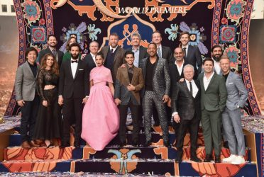 "LOS ANGELES, CA - MAY 21: (L-R front) Producer Dan Lin, actors Nasim Pedrad, Marwan Kenzari, Naomi Scott, Mena Massoud, Will Smith, Navid Negahban, Composer Alan Menken and co-lyricists Benj Pasek and Justin Paul. (L-R back) SVP, Production, The Walt Disney Studios, Louie Provost, Walt Disney Studios President, Alan Bergman, Director Guy Ritchie, Chairman, The Walt Disney Studios, Alan Horn, President of Walt Disney Studios Motion Picture Production, Sean Bailey, Producer Jonathan Eirich and actor Numan Acar attend the World Premiere of Disney's ""Aladdin"" at the El Capitan Theater in Hollywood CA on May 21, 2019, in the culmination of the film's Magic Carpet World Tour with stops in Paris, London, Berlin, Tokyo, Mexico City and Amman, Jordan. (Photo by Alberto E. Rodriguez/Getty Images for Disney) *** Local Caption *** Dan Lin; Nasim Pedrad; Marwan Kenzari; Naomi Scott; Mena Massoud; Will Smith; Navid Negahban; Alan Menken; Benj Pasek; Justin Paul; Louie Provost; Alan Bergman; Guy Ritchie; Alan Horn; Sean Bailey; Jonathan Eirich; Numan Acar"