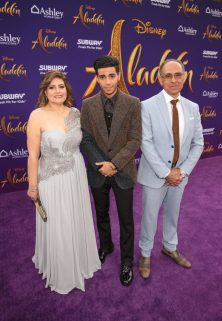 "LOS ANGELES, CA - MAY 21: Mena Massoud (C) and guests attend the World Premiere of Disney's ""Aladdin"" at the El Capitan Theater in Hollywood CA on May 21, 2019, in the culmination of the film's Magic Carpet World Tour with stops in Paris, London, Berlin, Tokyo, Mexico City and Amman, Jordan. (Photo by Jesse Grant/Getty Images for Disney) *** Local Caption *** Mena Massoud"