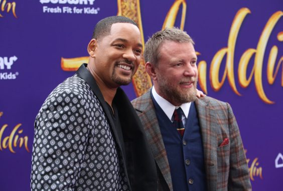 "LOS ANGELES, CA - MAY 21: Will Smith (L) and Director Guy Ritchie attend the World Premiere of Disney's ""Aladdin"" at the El Capitan Theater in Hollywood CA on May 21, 2019, in the culmination of the film's Magic Carpet World Tour with stops in Paris, London, Berlin, Tokyo, Mexico City and Amman, Jordan. (Photo by Jesse Grant/Getty Images for Disney) *** Local Caption *** Will Smith; Guy Ritchie"