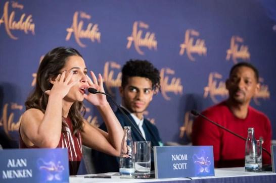 "(L-R) Naomi Scott, Mena Massoud and Will Smith attend the ""Aladdin"" press conference on May 11, 2019 in Berlin, Germany. .© Disney/Folioscope/Hanna Boussouar"