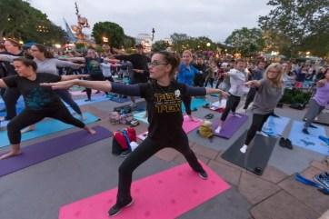 Disney Hosts International Yoga Day In Front Of Sleeping Beauty
