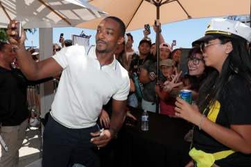 SAN DIEGO, CALIFORNIA - JULY 20: Anthony Mackie (L) and fans attend the #IMDboat at San Diego Comic-Con 2019: Day Three at the IMDb Yacht on July 20, 2019 in San Diego, California. (Photo by Rich Polk/Getty Images for IMDb)