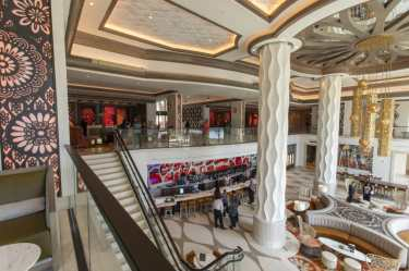 Guests at a preview of the new Gran Destino Tower at Disney's Coronado Springs Resort are welcomed into a stunning two-level lobby. Gran Destino Tower opens July 9 at Walt Disney World Resort in Lake Buena Vista, Florida. (Steven Diaz, photographer)