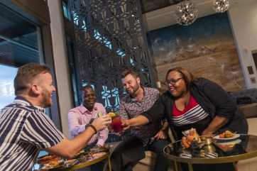 Guests enjoying a preview of Dahlia Lounge atop the new Gran Destino Tower at Disney's Coronado Springs Resort delight in signature cocktails crafted by expert mixologists and panoramic views. Gran Destino Tower opens July 9 at Walt Disney World Resort in Lake Buena Vista, Florida. (Steven Diaz, photographer)