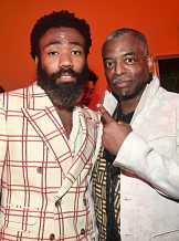 """HOLLYWOOD, CALIFORNIA - JULY 09: Donald Glover and LeVar Burton attend the World Premiere of Disney's """"THE LION KING"""" at the Dolby Theatre on July 09, 2019 in Hollywood, California. (Photo by Alberto E. Rodriguez/Getty Images for Disney)"""