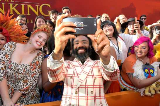 """HOLLYWOOD, CALIFORNIA - JULY 09: Donald Glover attends the World Premiere of Disney's """"THE LION KING"""" at the Dolby Theatre on July 09, 2019 in Hollywood, California. (Photo by Charley Gallay/Getty Images for Disney)"""