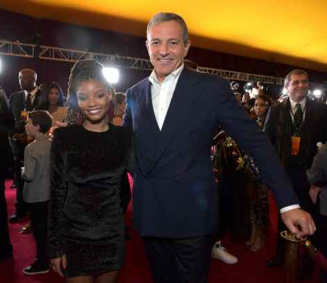 """HOLLYWOOD, CALIFORNIA - JULY 09: Halle Bailey and The Walt Disney Company Chairman and CEO Bob Iger attend the World Premiere of Disney's """"THE LION KING"""" at the Dolby Theatre on July 09, 2019 in Hollywood, California. (Photo by Charley Gallay/Getty Images for Disney)"""