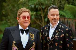 "LONDON, ENGLAND - JULY 14: Sir Elton John and David Furnish attend the European Premiere of Disney's ""The Lion King"" at Odeon Luxe Leicester Square on July 14, 2019 in London, England. (Photo by Gareth Cattermole/Getty Images for Disney)"