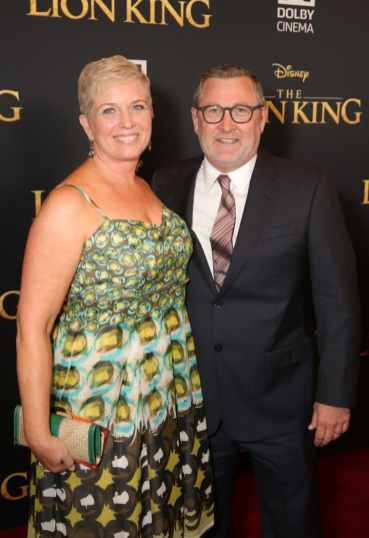 """HOLLYWOOD, CALIFORNIA - JULY 09: Executive producer Tom Peitzman (R) and guest attend the World Premiere of Disney's """"THE LION KING"""" at the Dolby Theatre on July 09, 2019 in Hollywood, California. (Photo by Jesse Grant/Getty Images for Disney)"""