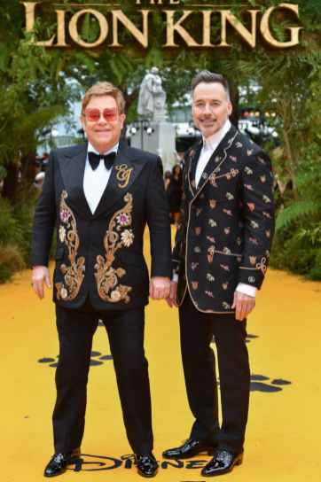 "Elton John and David Furnish attend the European Premiere of Disney's ""The Lion King"" at the Odeon Leicester Square on 14th July 2019 in London, UK"