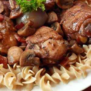 coq au vin recipe French France traditional authentic chicken wine bacon onions mushrooms