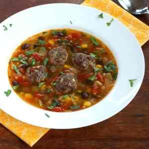 Mexican meatball soup stew recipe beef corn chipotles cilantro chorizo black beans