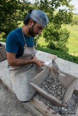 05.-Grinding-the-clay-that-has-been-dried-out.-jpg