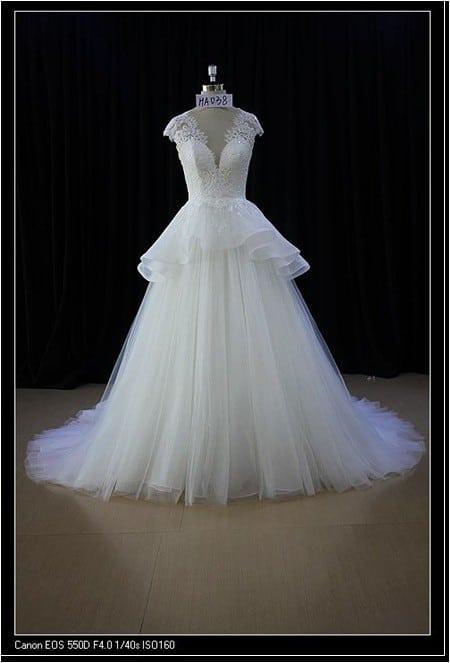 5597aadaf7 peplum wedding dress with cap sleeves · Darius Cordell close peplum style  ...