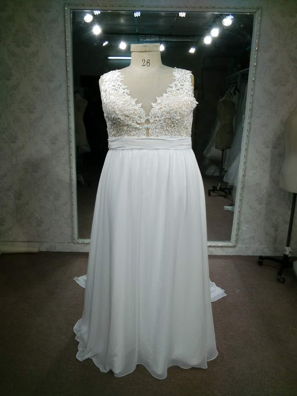 Empire waist plus size wedding gown by Darius Bridal